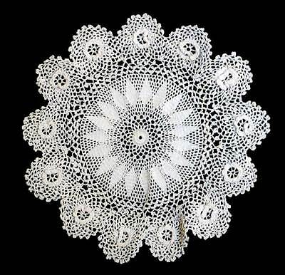 Vintage white intricate round lace doily measuring 22cm across