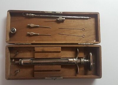 Old Antique Syringe Instrument In Wooden Box