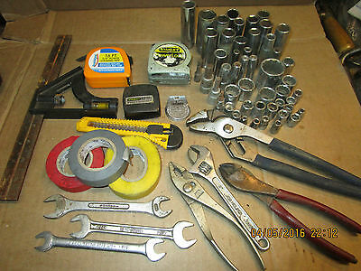 lot of vintage garage tools sockets wrenches tape rules pliers electrical tape