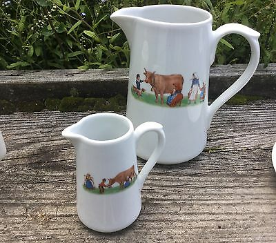2 French Apilco pitchers with a farm scene of milk maids and cow, 34 oz and 8 oz
