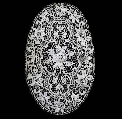 Vintage pretty intricate oval cutwork large doily measuring 42cm x 26cm
