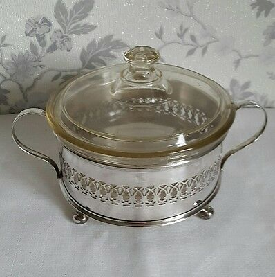 A Vintage Silver Plated Dish Holder with a Small Lidded Pyrex Casserole Dish