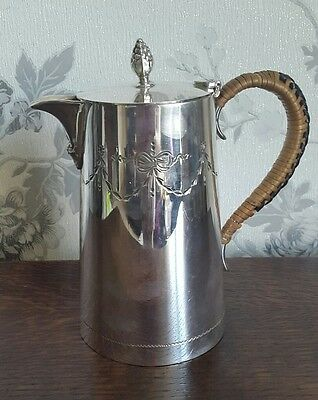 A Vintage Silver Plated Water Jug with Wicker Handke, James Dixon & Sons