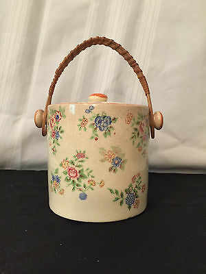 biscuit jar,Vintage Made in Japan. Cream colored with flowers & wicker handle