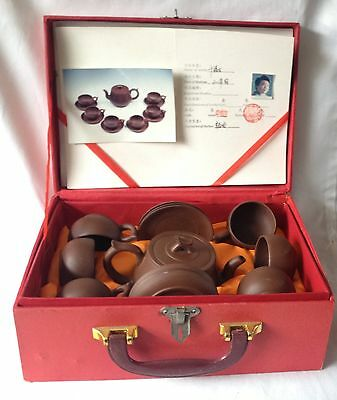 Boxed Yixing Oriental teapot plus 6 cups and saucers - seal mark on bases