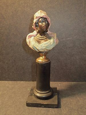 Vintage Heyde metal bust of an African woman with gold jewelry, on a pedestal