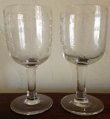 A pair of Danish hand wrought drinking glasses variously etched with toasts