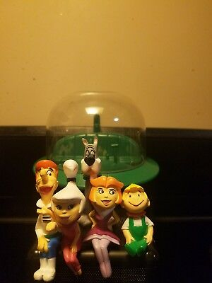 The Jetson car ,and characters, George,Jain,Judy,Elroy,and Astro.