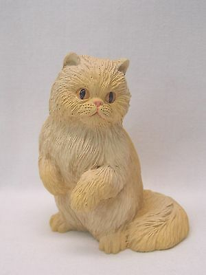 Orange Longhaired Cat Figurine  Made of Resin 3 1/4 In tall Gold eyes Nice