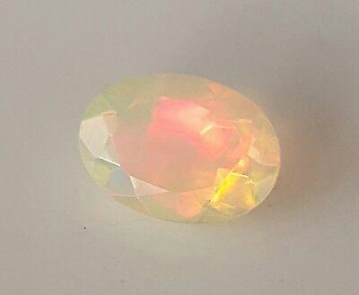 WaterfallGems Faceted Ethiopian Opal, 6.8x4.9mm, 0.47ct