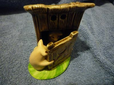 Pigs in outhouse figurine