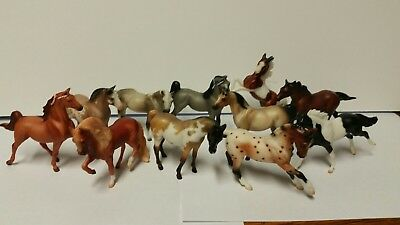 beyer horses about 3 in by 3 in ,11 total all different breeds