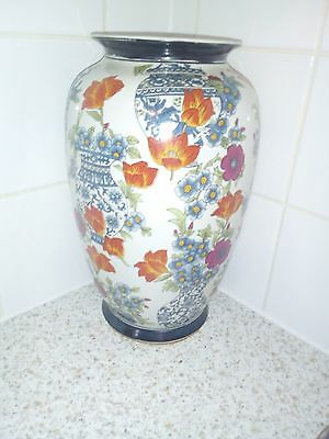Antique Japanese plate collection including vase