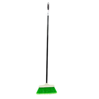 Green broom with a metal stick for outdoor use