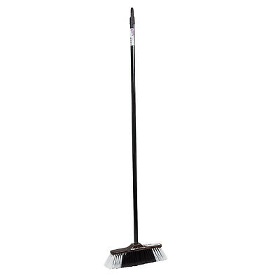 Brown classic broom with a metal stick for indoor use