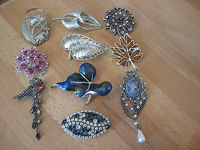 Brooch lot, 10 brooches, all silvertone, lots of rhinestones, enamel, cameo