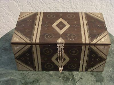 Wooden trinket box made in Africa with silver inlay and etched patterns