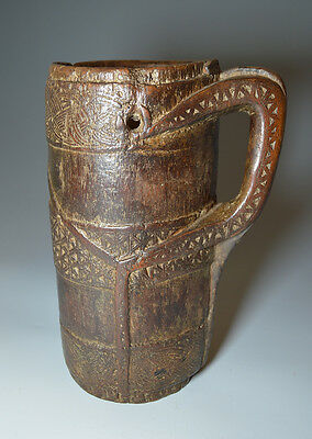 Beautiful very old carved Tribal milking jug from west Nepal