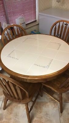 dinning room sets, good condition, brown wood trim and chairs with ceramic table