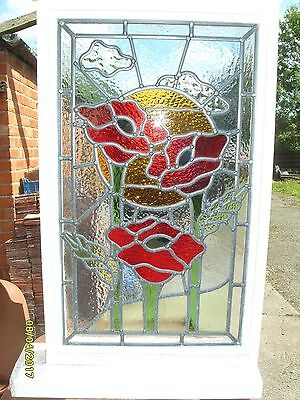 Antique style stained glass leaded window in frame