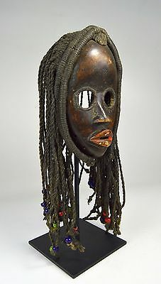 A Very Fine Dan African mask with Braided locks