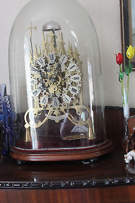 antique skelton clock double fusse with glass dome