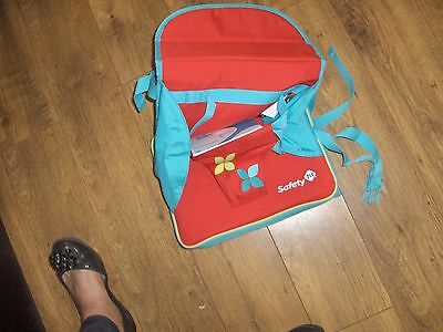 SafetyFirst travel highchair booster  red bought but never ued