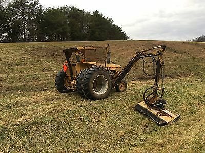 Ford 7610 boom mower tractor with tiger long arm mower.
