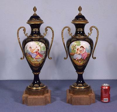 "Pair of 27"" Sevres Cobalt Blue Porcelain Urns with Gilt Bronze Fittings"