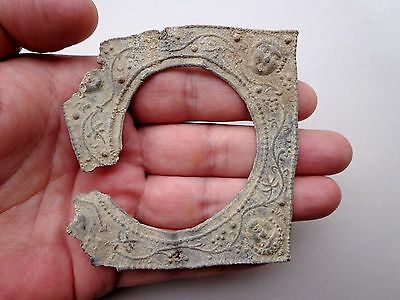 Roman lead plate, nicely floral decorated and Eros faces, damage in antiquity