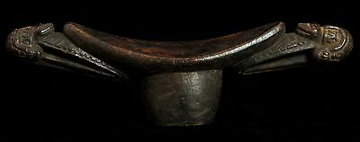 New Guinea carved headrest with small animal motifs