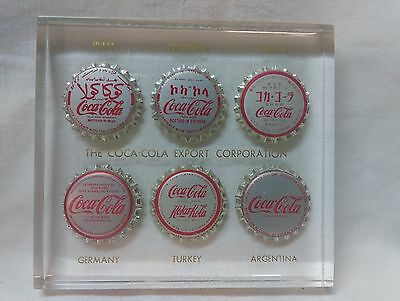 Coca-Cola Multi-National Bottle Caps in Lucite Paperweight