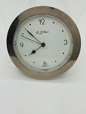 old watch or clock by r.j.carr
