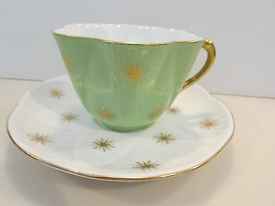 Shelley Snowflakes On Green Dainty Tea Cup And Saucer