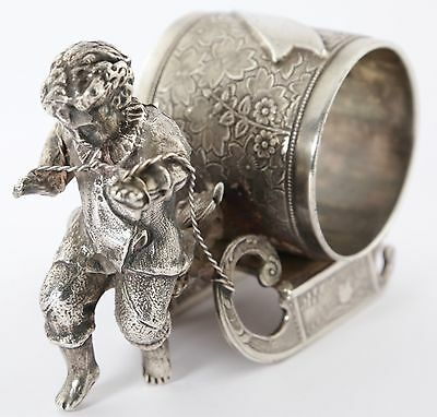 RARE ANTIQUE MERIDEN SILVER PLATED NAPKIN RING 'BOY PULLING SLED' No. 01576 1900