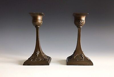 A Pair Of Patinated Arts & Crafts Decorated Minature Candlesticks
