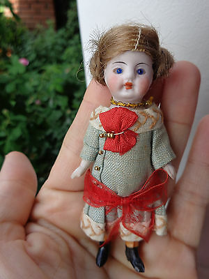 Antique German all bisque dollhouse doll c1900 closed mouth glass eyes old dress