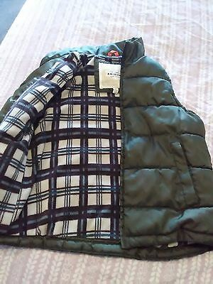 Boys size 8 fleece lined quilted puffer vest Green with plaid lining zip front