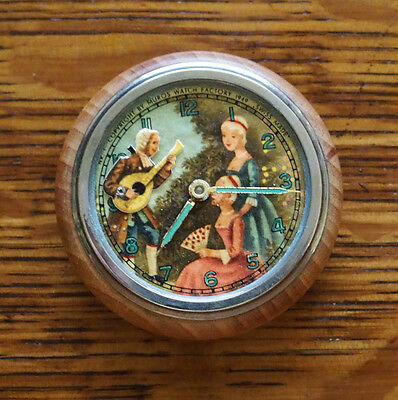 1949 Muros Animated Man Playing Instrument and Victorian Ladies Clock