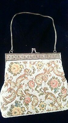 Vintage Womens beaded evening bag on tapestry fabric.