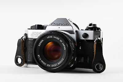 Canon AE-1 Program Camera with FD 50mm f1.8  and FD 75-200 4.5 Lens EXCELLENT!