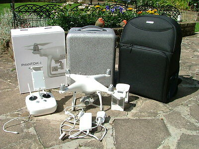 DJI Phantom P4 + 2 Batteries + original case and packing and soft back pack.
