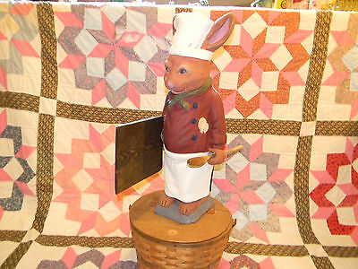 Restaurant decor and advertising Rabbit chef holding wooden peel and spoon