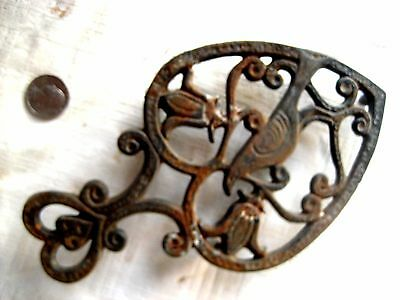 Antique ornate iron trivet