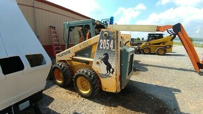 2004 Mustang 2054 Skid steer runs good has 2310 hrs cheap machine