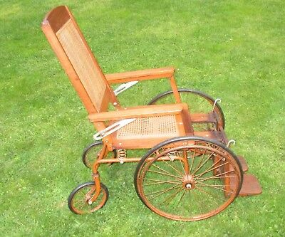 Antique Cane Seat Wood Frame Colson Wheelchair
