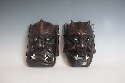 A Chinese Devil Mask black with horns hard wood set of 2 dark wood face Asian