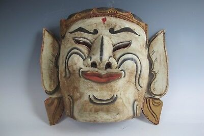 A Tibetan happy Warrior Mask white red paint wood face man clown performer act