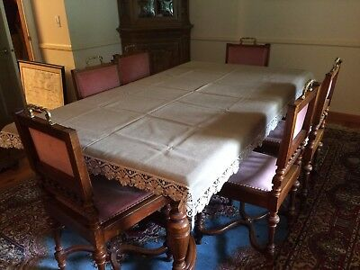 Antique walnut dining room table with 5 extension boards and six matching chairs
