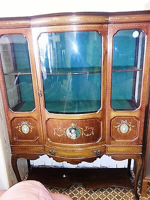 Early 20th century Edwardian inlaid bow  front glazed display cabinet.